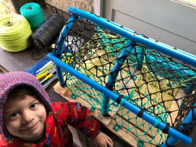 Three-year-old James with one of the crab pots made with his dad, which have been stolen