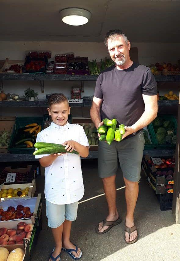 Henry Hoskin delivers his cucumbers to Shaun Lock, owner of Mawgan Stores