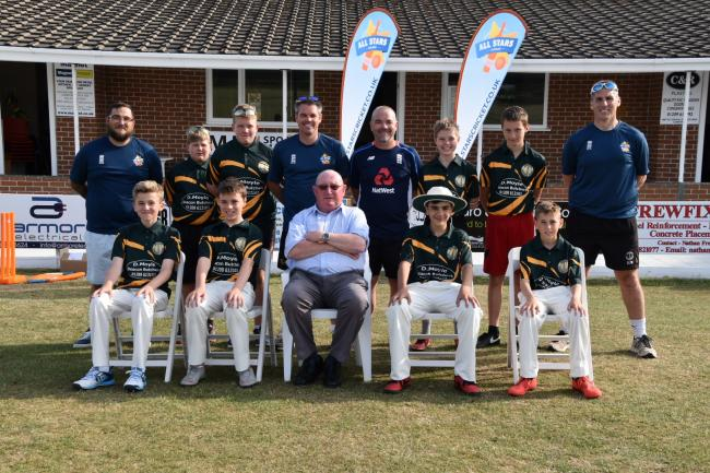 David Moyle (front centre) from Beacon Butchers presents the U13s team with their new shirts. Also pictured are Beacon youth coaches (in blue from left to right) David Wells, Darren Proctor, Simon Tripconey and David Williams.