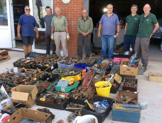Some of the team from Amigos with the tools donated at RGB Building Supplies' branches