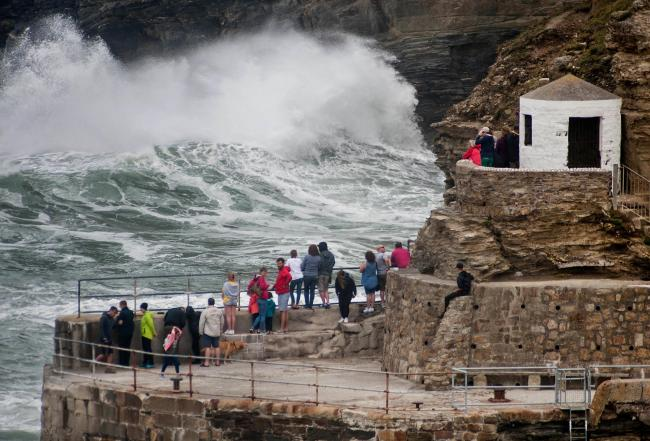 Wave watchers at Portreath. Picture: Colin Higgs.