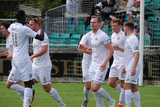 The Truro City players celebrate James Ward's goal in the White Tigers' FA Cup victory. Picture by Cameron Weldon