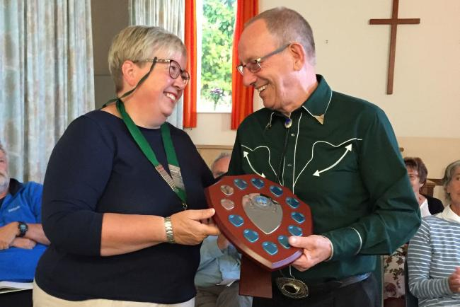 Parish council chair Sarah Lyne presents Walter Sanger with his award. Photo: Katie Nightingale