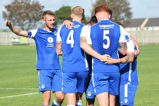 Helston's players celebrate Scott Beattie's goal in their FA Vase tie at home to Axminser Town