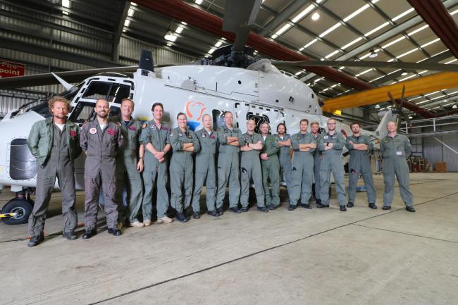 Members of Royal Netherlands Navy 7 Squadron inside the hangar of 820 Naval Air Squadron at RNAS Culdrose