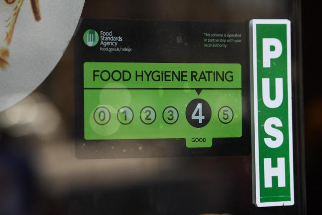 A Food Standards Agency rating sticker on a window of a restaurant in central London. A huge variation in food hygiene standards remains across the UK, with one in five high or medium-risk food outlets failing to meet standards, according to a study.