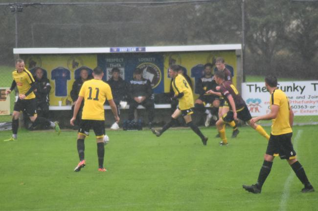 The match was played in torrential rain at the Underlane