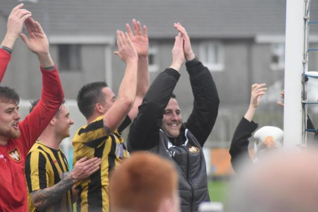 Falmouth Town boss Andrew Westgarth celebrates with his team and the F-Troop at full-time