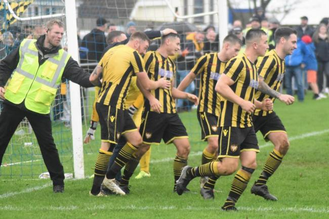 The Falmouth Town players celebrate the fourth goal of their 5-1 win at Helston Athletic on Saturday