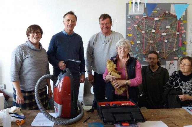 Former MP Andrew George takes along his vaccum cleaner to be fixed at Helston Repair Cafe