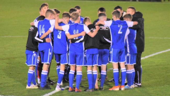 Helston Athletic players have a post-match huddle following their FA Youth Cup defeat at Forest Green Rovers on Tuesday night