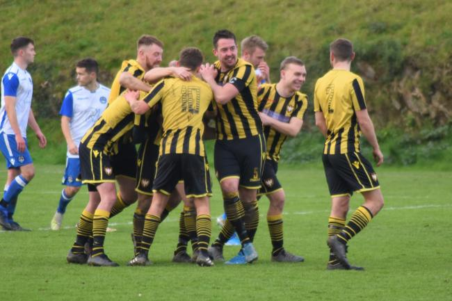 Falmouth's players celebrate David Broglino's second goal in their 3-2 win at home to Helston Athletic