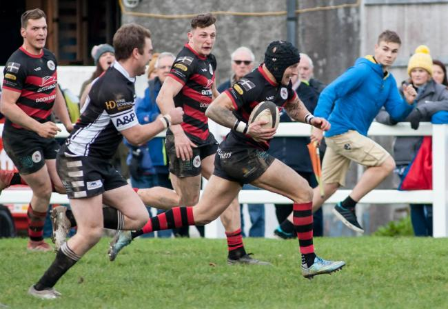 Penryn's Josh Chambers runs home a try in their derby victory at Falmouth in November. Picture by Colin Higgs