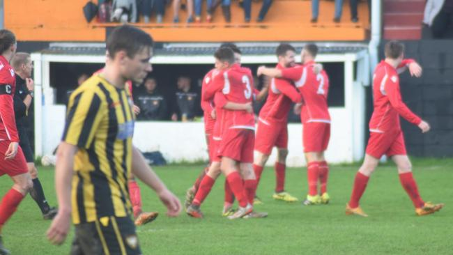 Wadebridge Town players celebrate taking the lead in their 4-3 win at Falmouth Town on Saturday