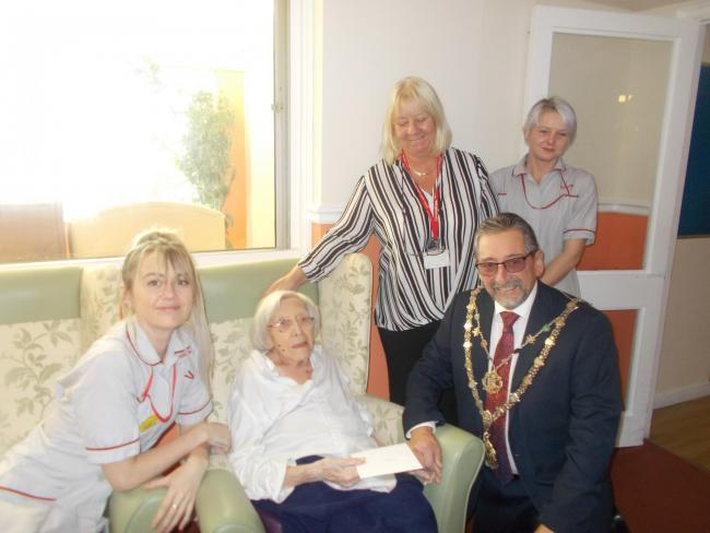 Mayor of Truro Bob Smith with Gladys Brown and staff