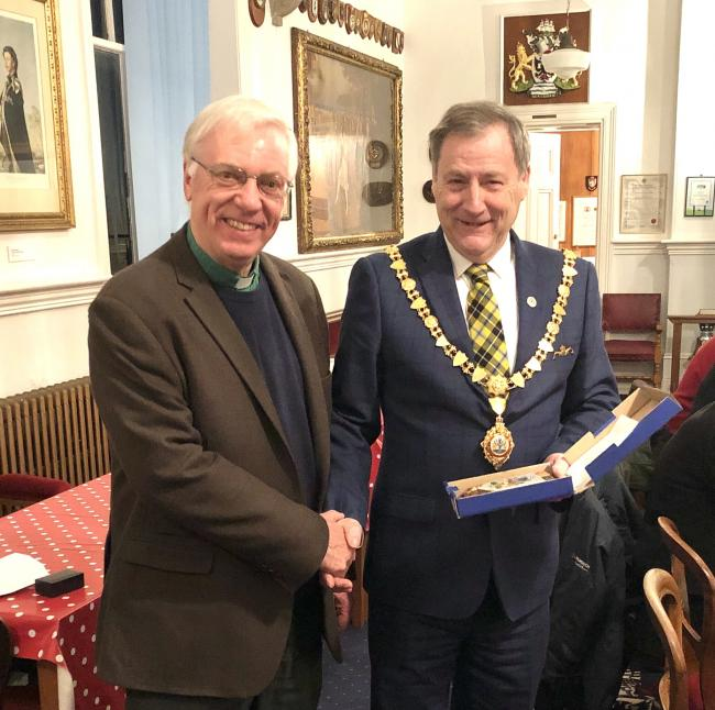 Mayor Steve Eva presenting Reverend Tudgey with a Falmouth plaque