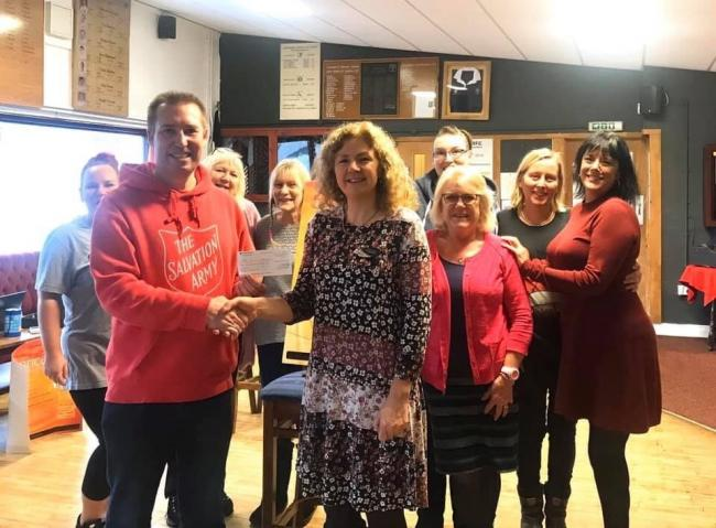 Andrew Hammond from Salvation Army visited Falmouth Slimming World to pick up a cheque for £120 raised by the group