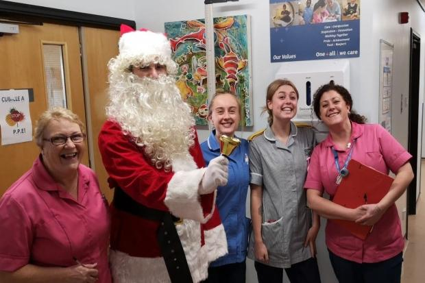 Father Christmas with staff at the Royal Cornwall Hospital. Photo: Royal Navy