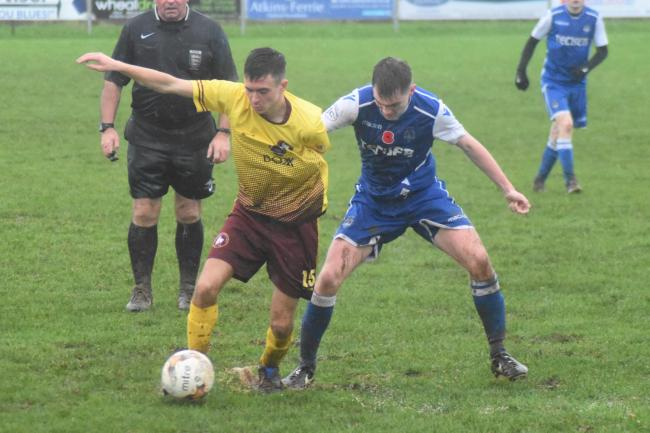 Wendron's Lucas Potts and Helston's Harrison Jewell during Saturday's game