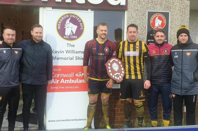 Captains and management of both Wendron United and Falmouth Town, together with Simon Williamson (second left) and the Kevin Williamson Memorial Shield