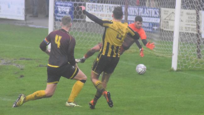 Luke Brabyn fires Falmouth Town in front in their 3-0 win at Wendron United on Boxing Day