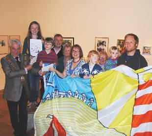 Mayor of Falmouth Geoffrey Evans presents Claire Trotman and her family, husband Peter and children Ada, 3 and Arthur 5 with her prize and hands over the student prize to Mollie Fielding, 13, her father Jonathan, brother Oliver and grandmother June