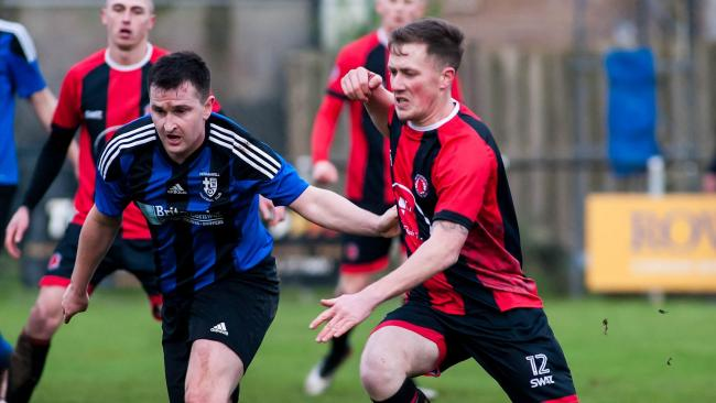 Lewis Pellow (right) in action for Penryn Athletic against Perranwell on Saturday. Picture by Colin Higgs