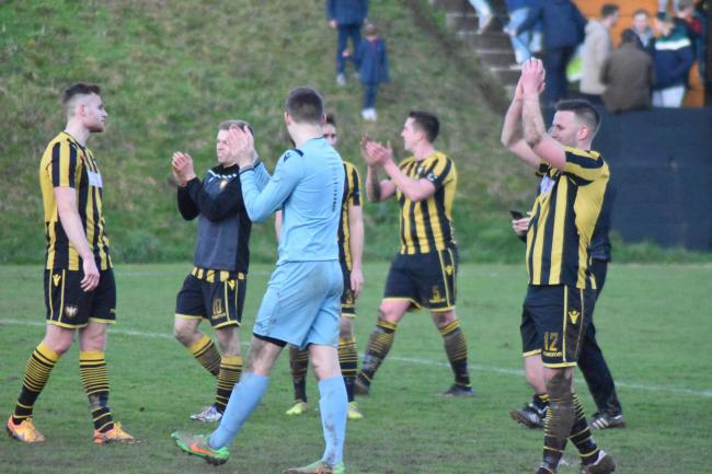 Andrew Westgarth (far right) applauds the Town supporters after their victory over Torridgeside in January