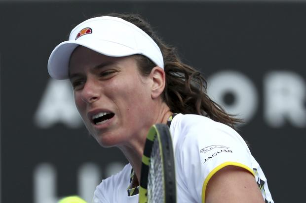 Johanna Konta hits a backhand during her defeat by Ons Jabeur