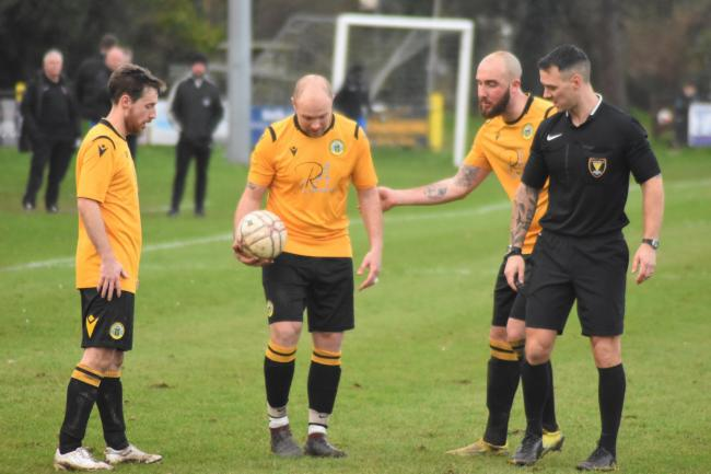 Porthleven co-manager Jamie Thomson (centre) played the final ten minutes of Saturday's game