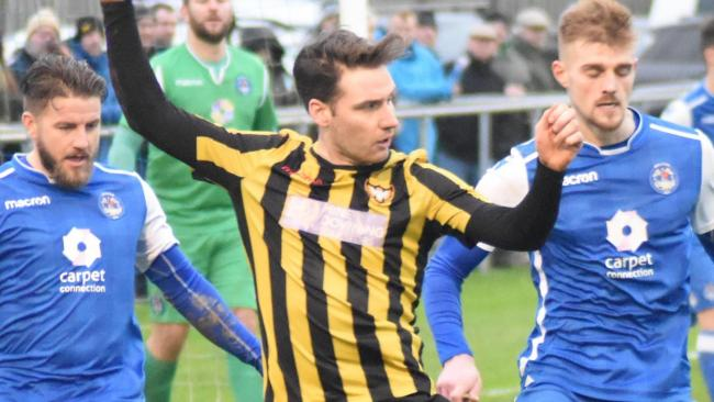 Ryan Chinn (centre) scored his first goal for Town on his return from a three-game suspension