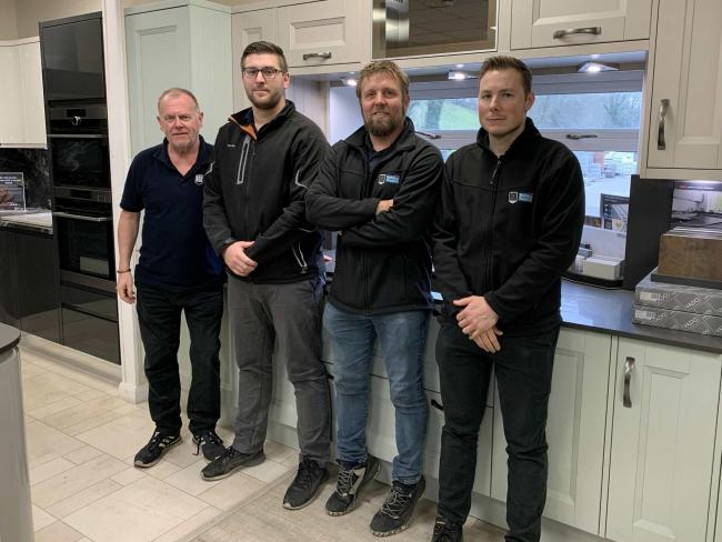 Branch manager Lee Atkinson, Jason Robertson from bathroom sales, kitchen manager Jamie Webb and Matt Benner from kitchen sales