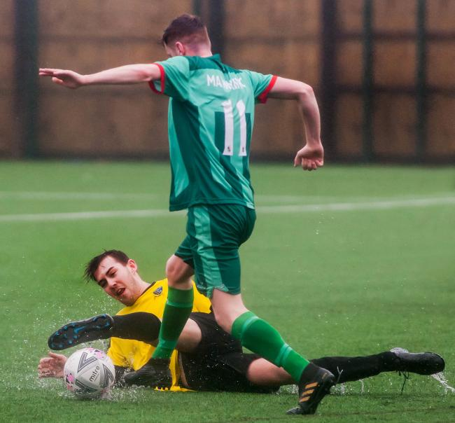 Mawnan's James Pollard twists inside Tom Shackleton. Picture by Colin Higgs