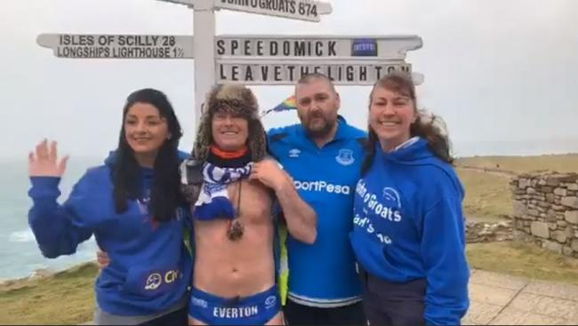 Speedo Mick with his team next to the famous Land's End signpost. Image: Speedo Mick/Facebook Live