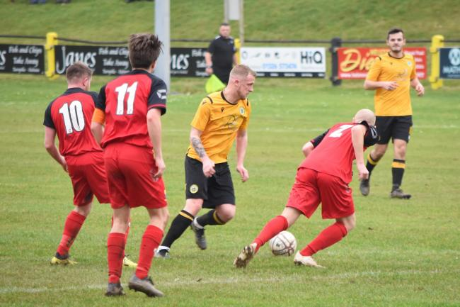 Joe Wright (centre) scored twice as Porthleven came back to win 3-2 at home to Sticker