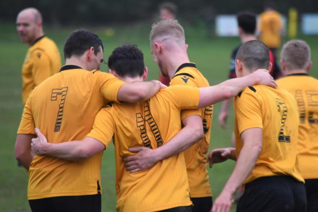 The Porthleven players celebrate their winning goal