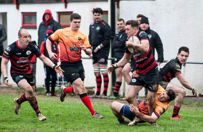 Penryn's Kyle Bradley tries to make a pass before he is felled by Chard's Paul Nichols. Picture by Colin Higgs