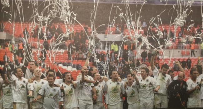 The Truro City players celebrate on the Wembley turf