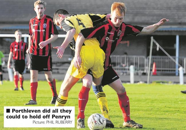 Penryn Athletic's Russell May and Porthleven's Dan Tarrant. Pic: Phil Ruberry