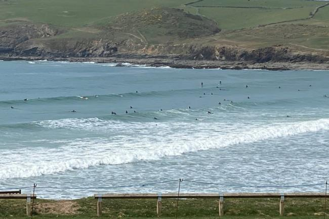 Around 50 surfers seen in the sea at Polzeath - despite RNLI advice to stay out of the water during lockdown. Picture: SWNS/Polzeath Coastguard