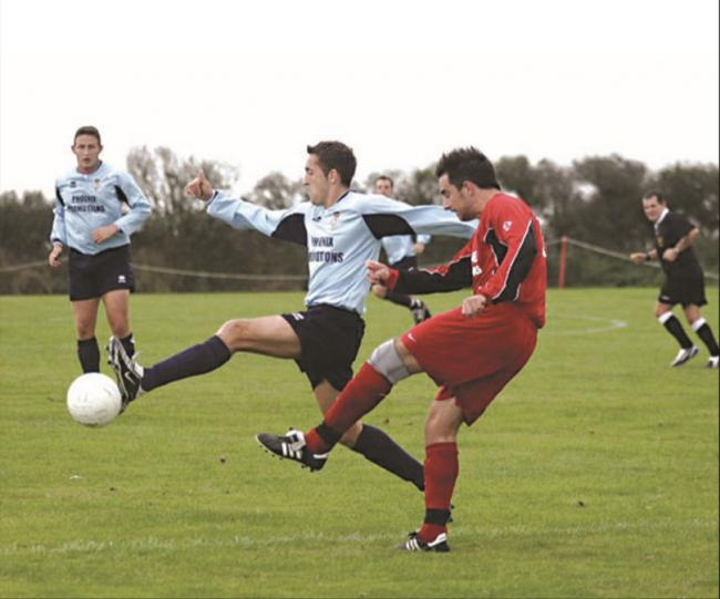 Culdrose and Helston players battle for possession at the air station. Pic: Colin Banfield