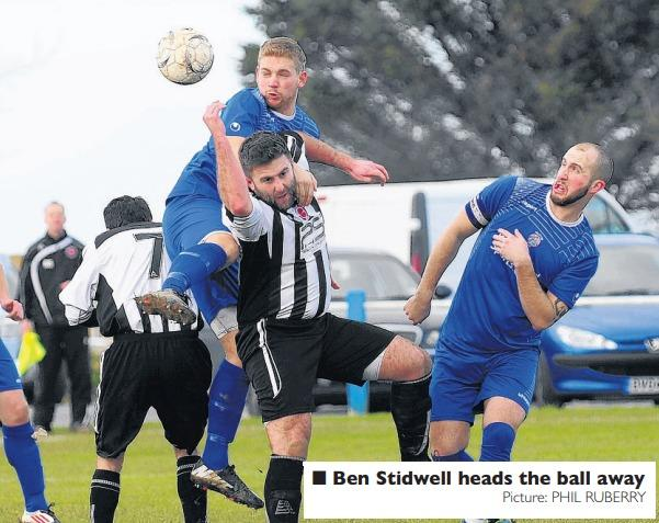 Blues defender Ben Stidwell heads the ball away. Pic: Phil Ruberry