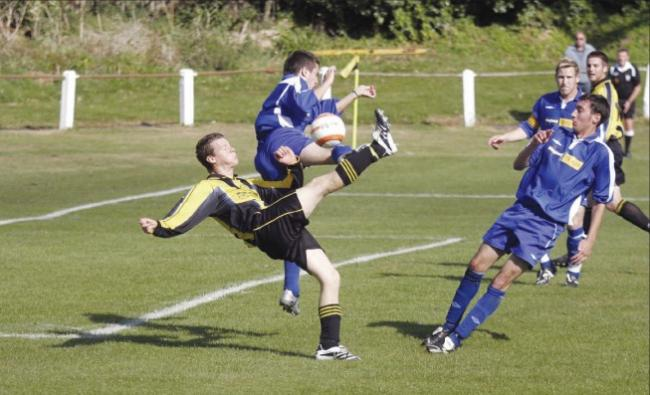 It's an acrobatic kick from Mike Brewer as Bridport's defence is put underpressure by Porthleven. Pic: Colin Banfield