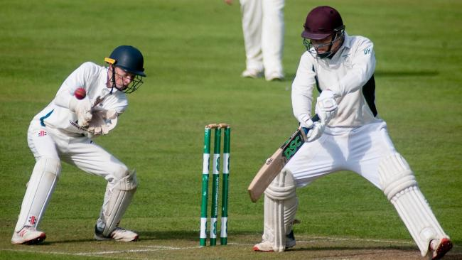 Falmouth wicket keeper Aiden Carter fields a ball off the bat of Grampound Road's David Hoskins during the 2019 season. Picture by Colin Higgs