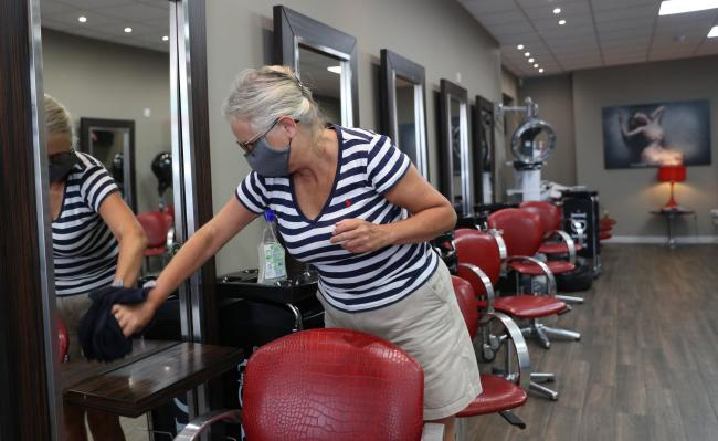A hair salon manager prepares for reopening ahead of the Prime Minister setting out plans to allow pubs, restaurants, museums and cinemas to begin reopening in the latest easing of the coronavirus lockdown in England. Picture: Andrew Matthews/PA Wire