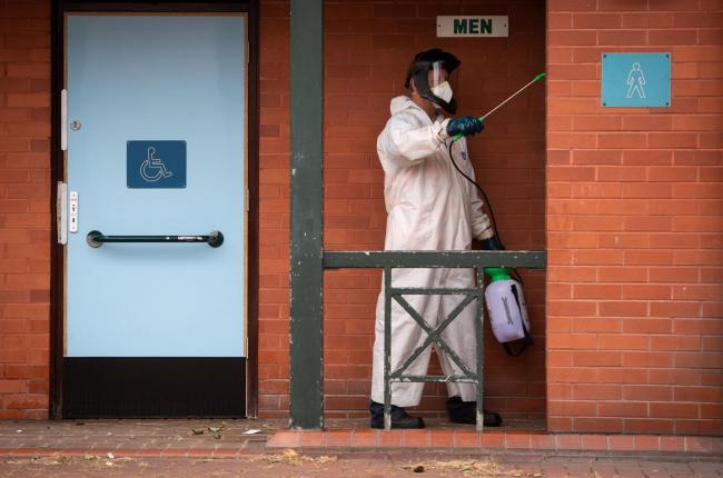 A worker disinfects public toilets. Picture: Joe Giddens/PA Wire