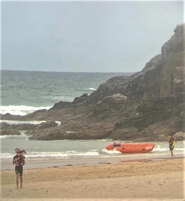 RNLI lifeguards rescuing Ronnie the dog at Perranporth. Picture: RNLI