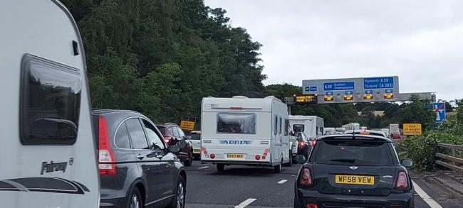 Queuing caravans and cars on the southbound junction of the A30 and M5 this morning. Photo: Donna Williams