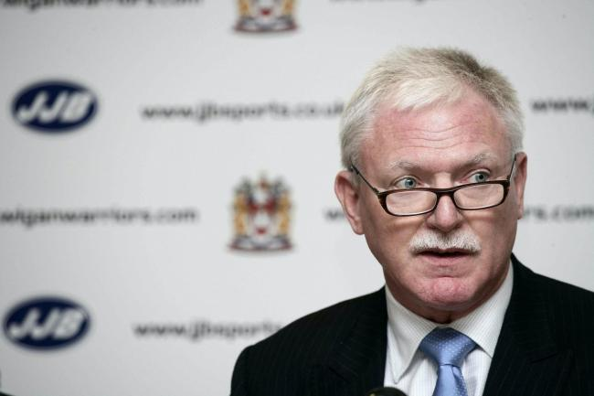 A bid by Wigan Warriors owner Ian Lenagan, pictured, for the football club has been given council backing