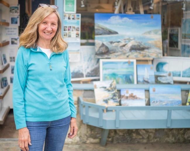 Artist Jeanni Grant-Nelson in her Art At The Beach gallery at Mawgan Porth, near Newquay